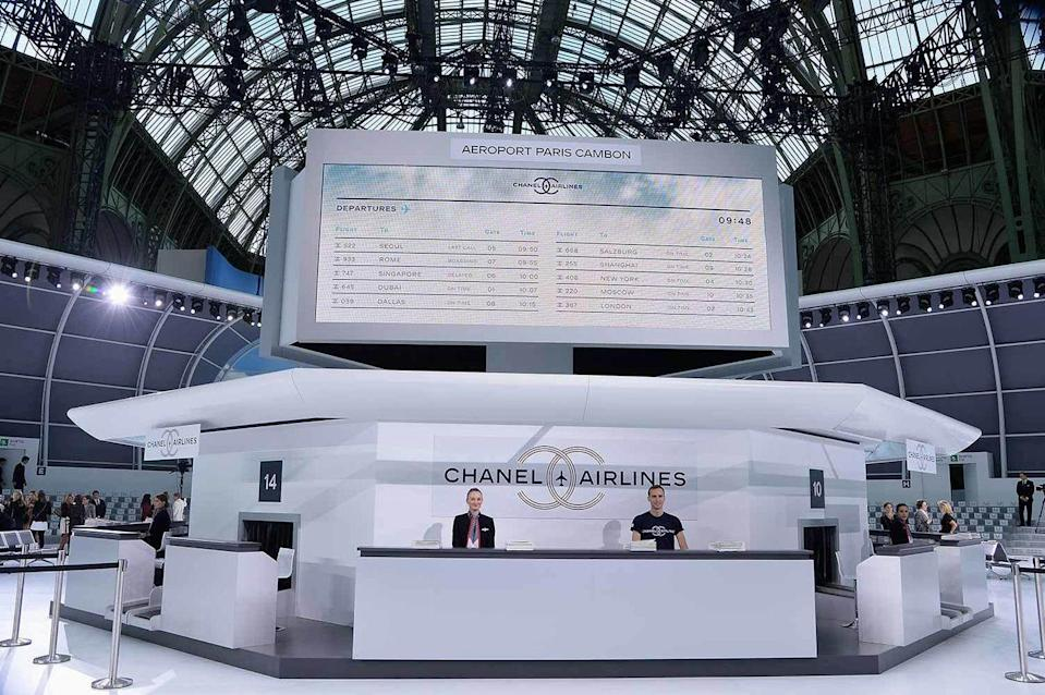 <p>All aboard Chanel airways report to gate No. 5, obviously. For SS16 Karl Lagerfeld took the Chanel show global. Coloured tweed suits finished off with a quilted travel case wheeled round the airport like set. Only this could happen at a Chanel show. </p>