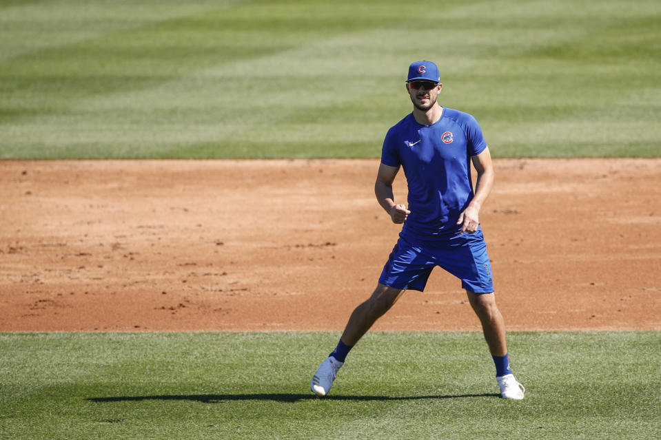 Chicago Cubs third baseman Kris Bryant warms up during baseball practice at Wrigley Field on Friday, July 3, 2020 in Chicago. (AP Photo/Kamil Krzaczynski)