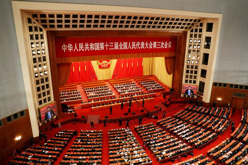FILE PHOTO: Chinese officials and delegates attend the closing session of NPC in Beijing