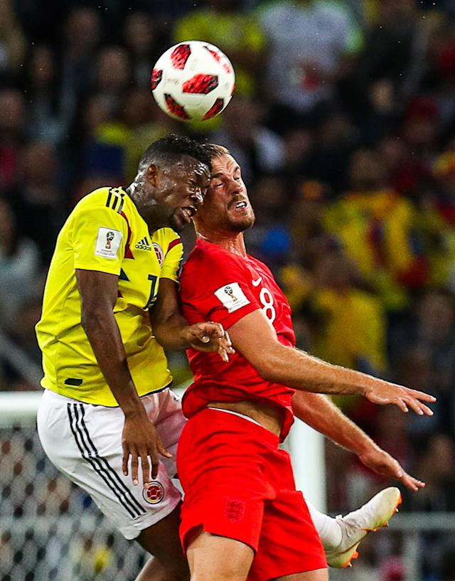 <p>Colombia's Jefferson Lerma (L) and England's Jordan Henderson head the ball in their 2018 FIFA World Cup Round of 16 match at Spartak Stadium. Mikhail Tereshchenko/TASS (Photo by Mikhail Tereshchenko\TASS via Getty Images) </p>