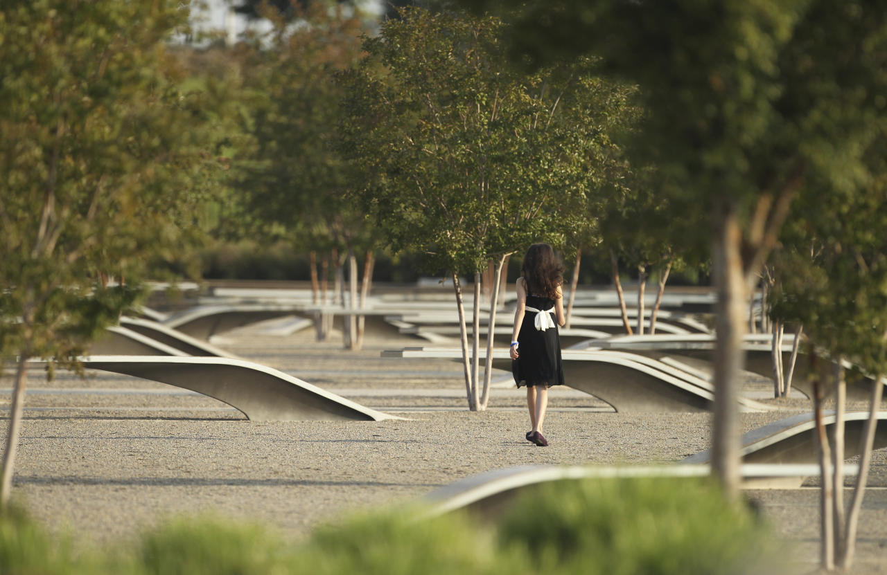 A young relative of one of the victims of the attack on the Pentagon walks through the memorial for the victims during ceremonies marking the 10th anniversary of the 9/11 attacks on the Pentagon, in Washington September 11, 2011.  (REUTERS/Molly Riley)