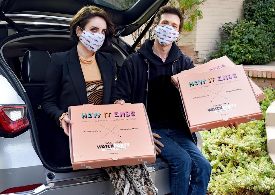 <p>Zoe Lister-Jones and Daryl Wein deliver pizzas to the <em>How It Ends</em> cast and crew in the 2022 Acura MDX to celebrate the film's virtual Sundance Film Festival premiere on Saturday in Studio City, California.</p>