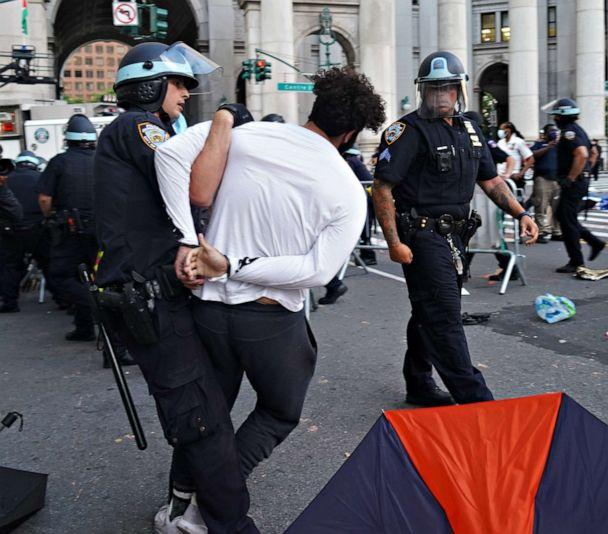 PHOTO: Protestors gather at city hall on July 1, 2020 in New York City. NYPD officers arrested two people and injured several others during a violent confrontation with protesters at City Hall Park on June 30, 202. (NurPhoto via Getty Images)