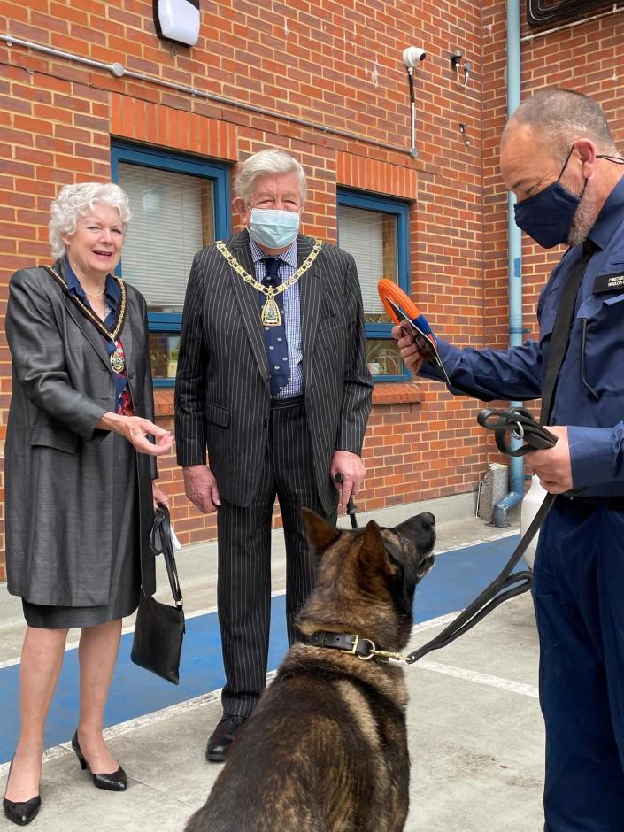 The Mayor and Mayoress of Bromley presented Kaiser with a new toy on his return. (Croydon Police)