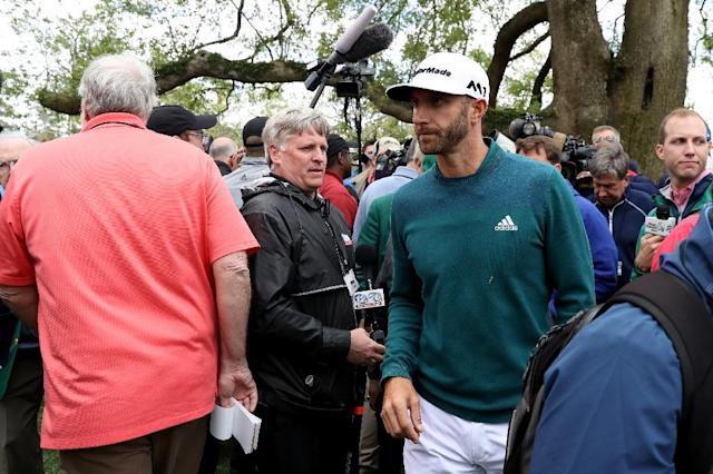 Dustin Johnson of the United States walks off after announcing his withdrawl to the media during the first round of the 2017 Masters Tournament at Augusta National Golf Club on April 6, 2017 in Augusta, Georgia (AFP Photo/Rob Carr)