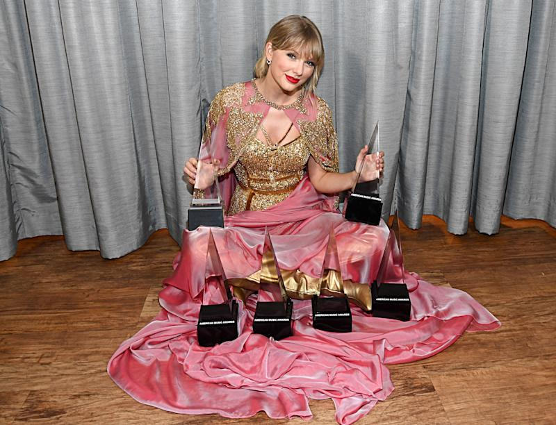 Taylor Swift showing off her awards
