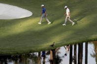 Jon Rahm, left, and Dustin Johnson walk to the 16th green during the third round of the Masters Saturday, Nov. 14, 2020, in Augusta, Ga. (Curtis Compton/Atlanta Journal-Constitution via AP)