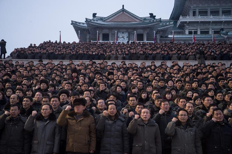 North Koreans gather for a new year address made by Kim Jong-Un in which he said the country had completed its nuclear deterrent (AFP Photo/KIM Won-Jin)