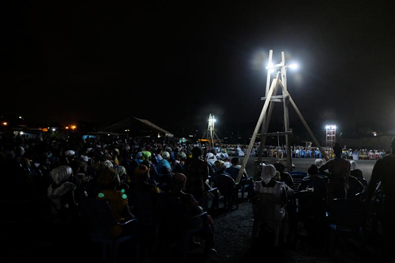 Crowds sit for late-night church service in Obuasi, Ghana. (Photo: Francis Kokoroko/Reuters)