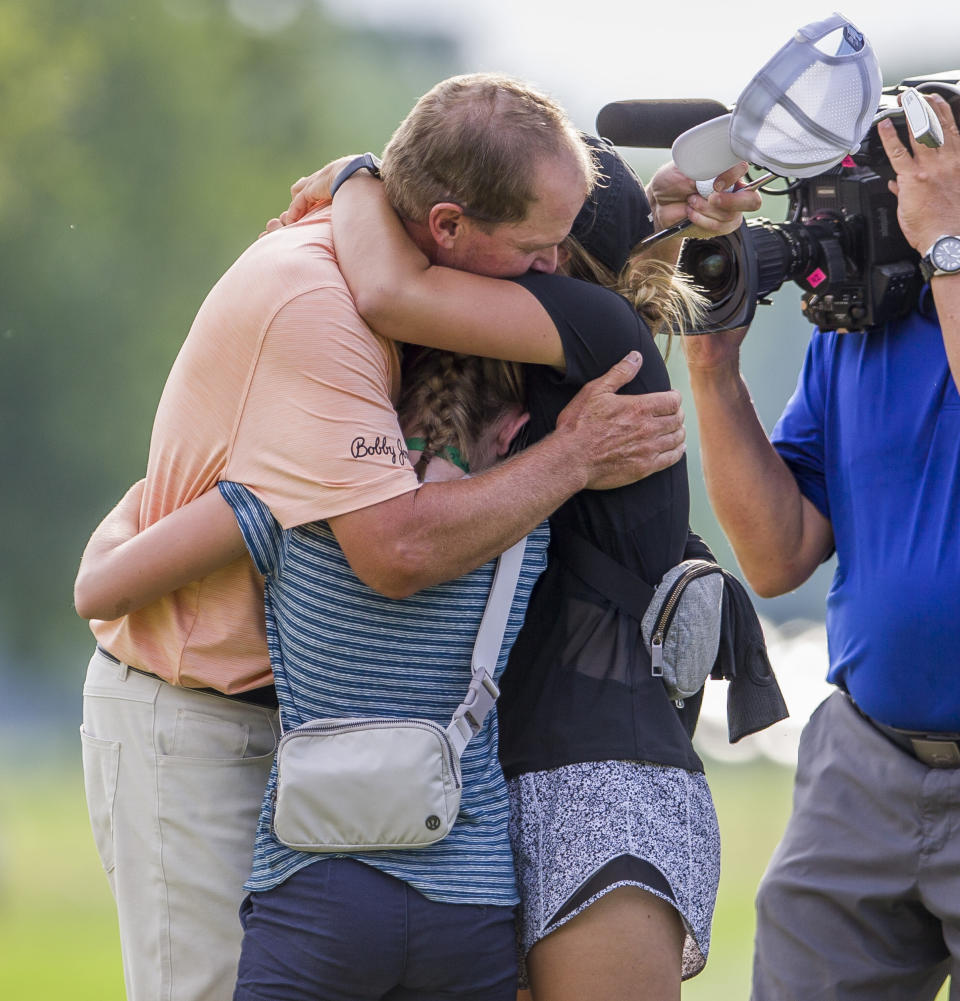 Steve Stricker hugs family members after winning the U.S. Senior Open following the final round of play on Sunday, June 30, 2019, at Notre Dame's Warren Golf Course in South Bend, Ind. (Michael Caterina/South Bend Tribune via AP)