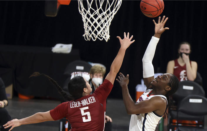 Arizona guard Bendu Yeaney (23) shoots as Washington State guard Charlisse Leger-Walker (5) defends during the first half of an NCAA college basketball game in the second round of the Pac-12 women's tournament Thursday, March 4, 2021, in Las Vegas. (AP Photo/Isaac Brekken)