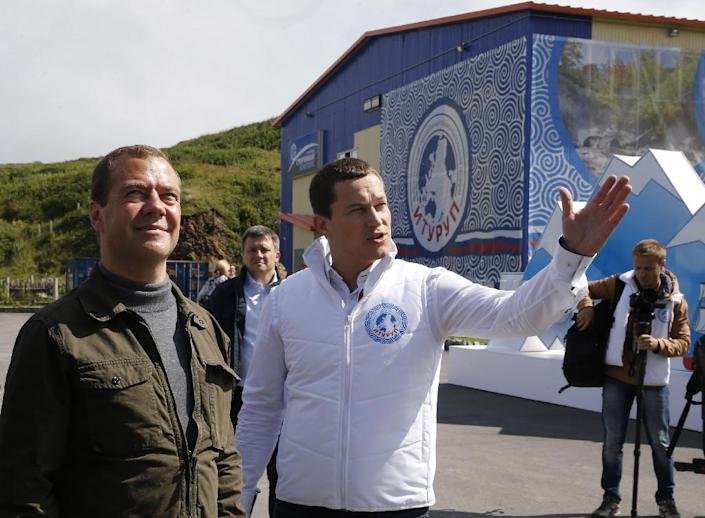 """Dmitry Medvedev (left) attends the all-Russian youth educational forum """"Iturup"""" in Kurilsk during his visit to Iturup island, on August 22, 2015 (AFP Photo/Dmitry Astakhov)"""