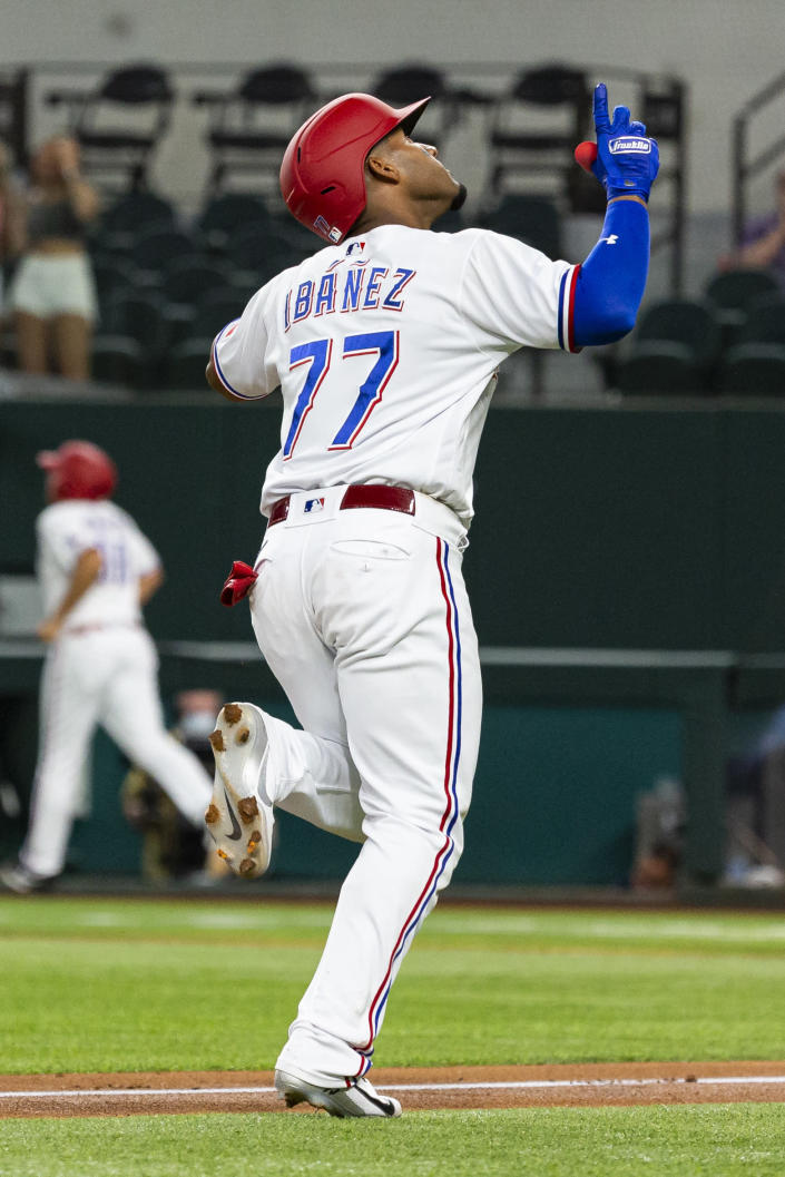 Texas Rangers' Andy Ibáñez (77) celebrates after hitting a home run during the first inning of a baseball game against the Oakland Athletics, Monday, June 21, 2021, in Arlington, Texas. (AP Photo/Sam Hodde)