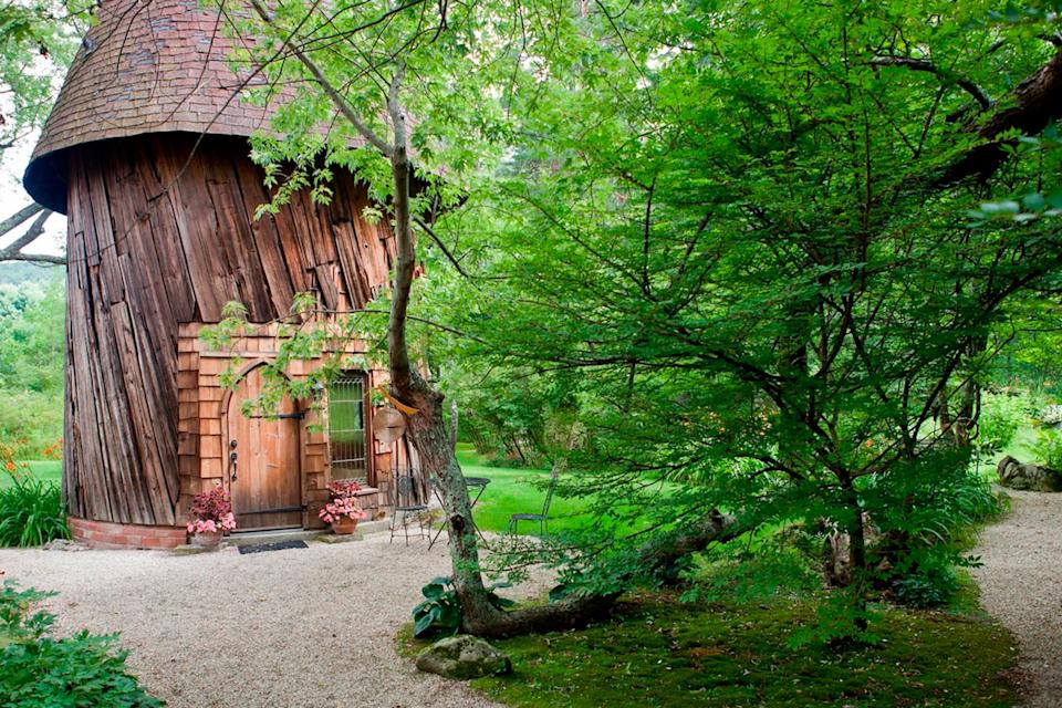 """<h2>Silo Studio Cottage</h2>This elven-looking cottage was a sculpting studio in its past life. Now, it's surrounded by garden paths, a babbling brook with stone bridges, and a stone bench seating area complete with a fire pit and firewood for guests to use. The massive windows give you a so-zen-it-looks-fake view of nearby trees and a lily pond. It's a charming escape from reality.<br><br><strong>Location: </strong>Tyringham, MA<br><strong>Sleeps: </strong>2<br><strong>Price Per Night: </strong>$244<br><br><strong><a href=""""https://www.airbnb.com/rooms/1238125"""" rel=""""nofollow noopener"""" target=""""_blank"""" data-ylk=""""slk:Book here"""" class=""""link rapid-noclick-resp"""">Book here</a></strong><span class=""""copyright"""">Photo: Courtesy of Airbnb.</span>"""