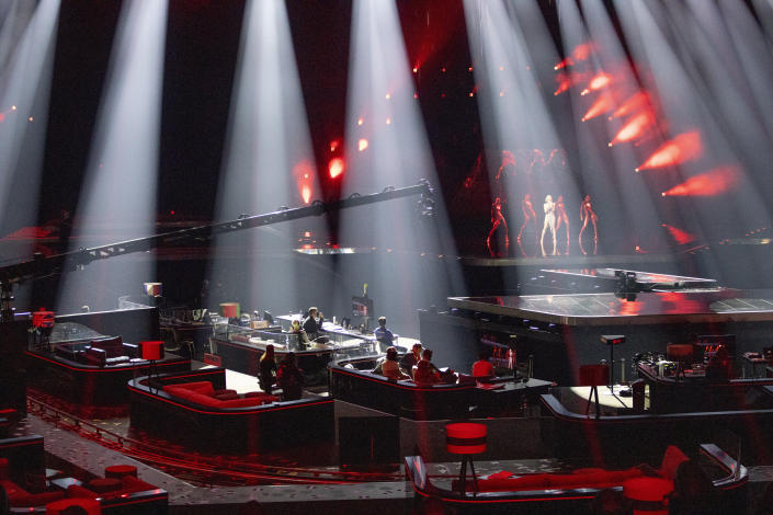 In this photo taken on May 12, 2021, the waiting booths of performing artists are seen in the foreground during rehearsals at the Eurovision Song Contest at Ahoy arena in Rotterdam, Netherlands. After last year's Eurovision Song Contest was canceled amid the global COVID-19 pandemic, it is roaring back to life with coronavirus bubbles added to its heady mix of music and camp. (AP Photo/Peter Dejong)