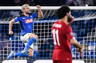 Oh no Mo: Mohamed Salah (right) watches on as Dries Mertens celebrates Napoli's opening goal in a rare Liverpool defeat on Tuesday (AFP Photo/Alberto PIZZOLI)
