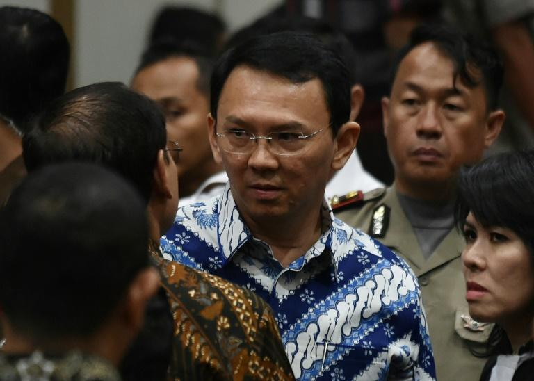 Jakarta's Christian governor Basuki Tjahaja Purnama (C), popularly known as Ahok, was jailed for two years on May 9 after being found guilty of committing blasphemy, capping a saga seen as a test of religious tolerance in the Muslim-majority nation