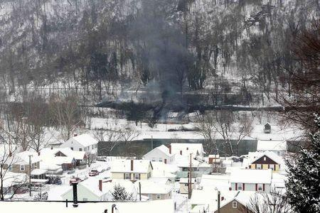 A CSX Corp train continues to smolder a day after derailing in Mount Carbon, West Virginia, Tuesday, February 17, 2015. REUTERS/Marcus Constantino