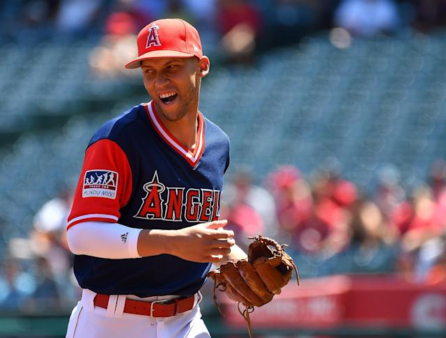 Andrelton Simmons heads off the field after the first inning of a game against the Astros on Aug. 27. (Getty Images)