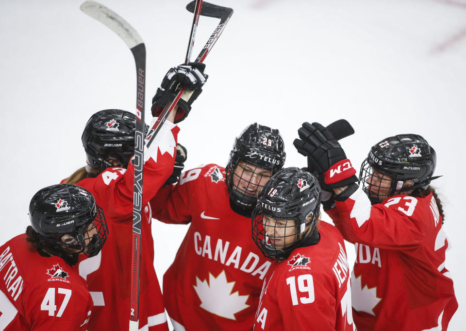 Canada's Marie-Philip Poulin (29) celebrates her goal against Finland with teammates during the second period of an IIHF women's hockey championship game in Calgary, Alberta, Friday, Aug. 20, 2021. (Jeff McIntosh/The Canadian Press via AP)