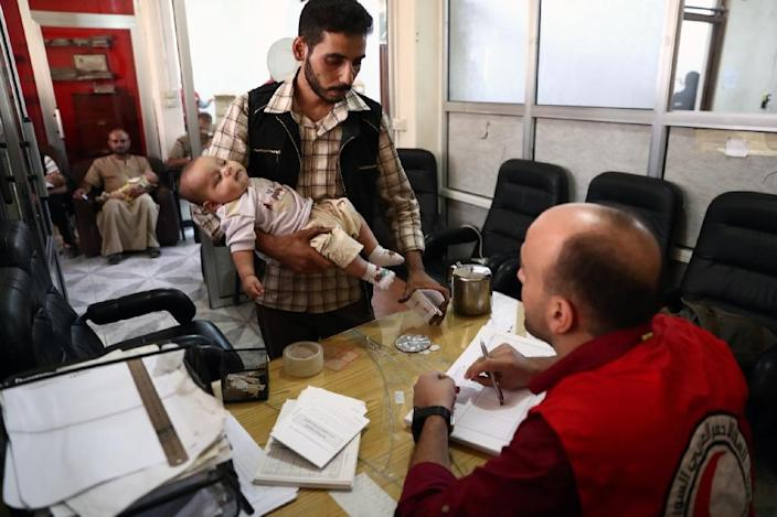A man registers during a vaccination campaign carried out by the Syrian Arab Red Crescent, on September 19, 2016, in the rebel-held town of Douma (AFP Photo/Abd Doumany)