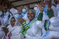 Women applaud as they sit in the stands at the final campaign rally of Ethiopia's Prime Minister Abiy Ahmed, in the town of Jimma in the southwestern Oromia Region of Ethiopia Wednesday, June 16, 2021. The country is due to vote in a general election on Monday, June, 21, 2021. (AP Photo/Mulugeta Ayene)