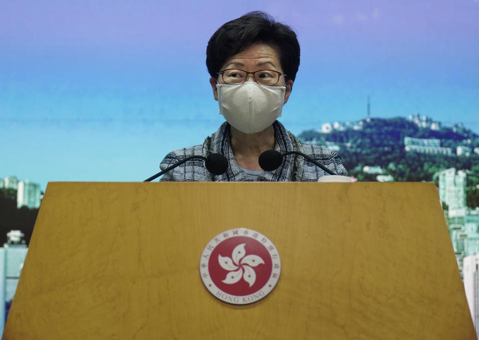 Hong Kong Chief Executive Carrie Lam listens to a reporter's questions during a press conference in Hong Kong, Monday, Oct. 12, 2020. Lam said Monday that her annual policy address scheduled for this week will be delayed until she travels to Beijing to ask the Chinese central government for help with measures to help her city's battered economy. (AP Photo/Vincent Yu)