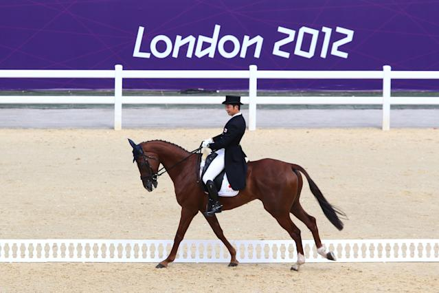 LONDON, ENGLAND - JULY 28: Toshiyuki Tanaka of Japan riding Marquis de Plescop competes in the Dressage Equestrian event on Day 1 of the London 2012 Olympic Games at Greenwich Park on July 28, 2012 in London, England. (Photo by Alex Livesey/Getty Images)