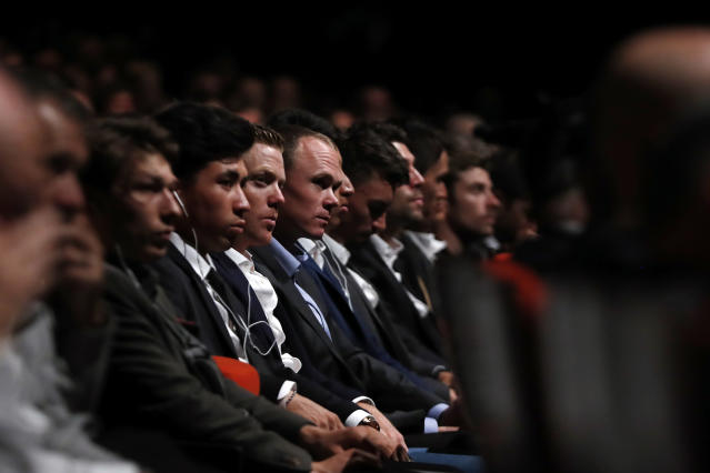 Britain's Chris Froome, center, attends the presentation of the Tour de France 2020 cycling race, in Paris, Tuesday Oct. 15, 2019. The 107th edition of the race starts on June 27 2019 to end on the Champs-Elysees avenue on July 19. (AP Photo/Thibault Camus)