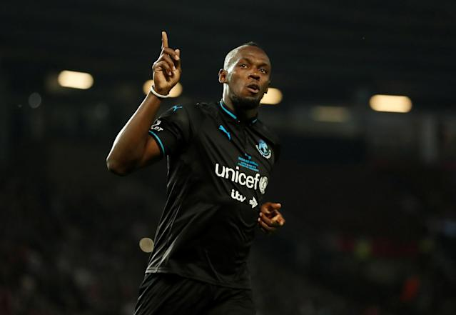 Soccer Football - Soccer Aid 2018 - England v Soccer Aid World XI - Old Trafford, Manchester, Britain - June 10, 2018 World XI's Usain Bolt celebrates scoring during the penalty shootout Action Images via Reuters/Andrew Boyers