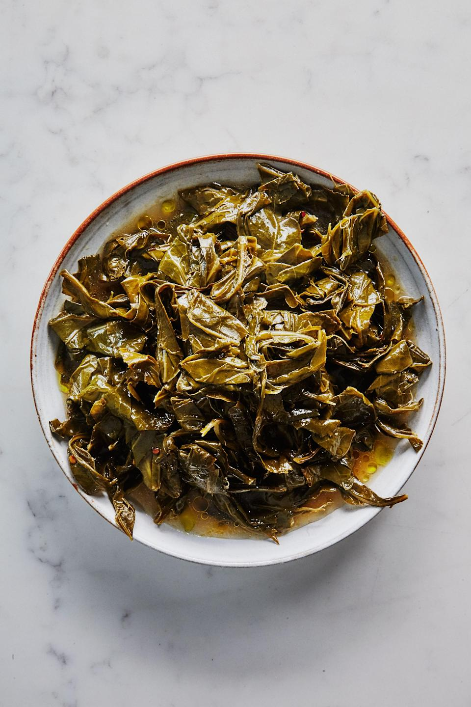 """Truth: Garlic sizzling in olive oil is the greatest smell in the world and the only base needed to transform everything from spaghetti to shrimp to these collards into something that's both simple and spectacular. <a href=""""https://www.bonappetit.com/recipe/slow-cooked-collard-greens-in-olive-oil?mbid=synd_yahoo_rss"""" rel=""""nofollow noopener"""" target=""""_blank"""" data-ylk=""""slk:See recipe."""" class=""""link rapid-noclick-resp"""">See recipe.</a>"""