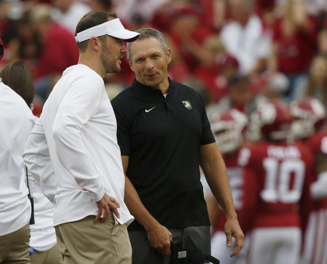 Oklahoma head coach Lincoln Riley, left, talks with Army head coach Jeff Monken, right, before an NCAA college football game in Norman, Okla., Saturday, Sept. 22, 2018. (AP Photo/Sue Ogrocki)
