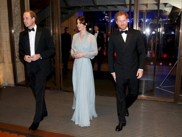 """Prince William, Duke of Cambridge, Catherine, Duchess of Cambridge, and  Prince Harry (R) attend The Cinema and Television Benevolent Fund's Royal Film Performance 2015 of the new James Bond 007 film """"Spectre"""" at Royal Albert Hall on October 26, 2015 in London, England."""
