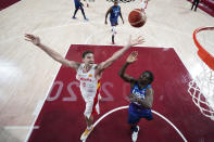 Spain's Pau Gasol (4) fights for a rebound with United States' Jrue Holiday, right, during a men's basketball quarterfinal round game at the 2020 Summer Olympics, Tuesday, Aug. 3, 2021, in Saitama, Japan. (AP Photo/Charlie Neibergall, Pool)