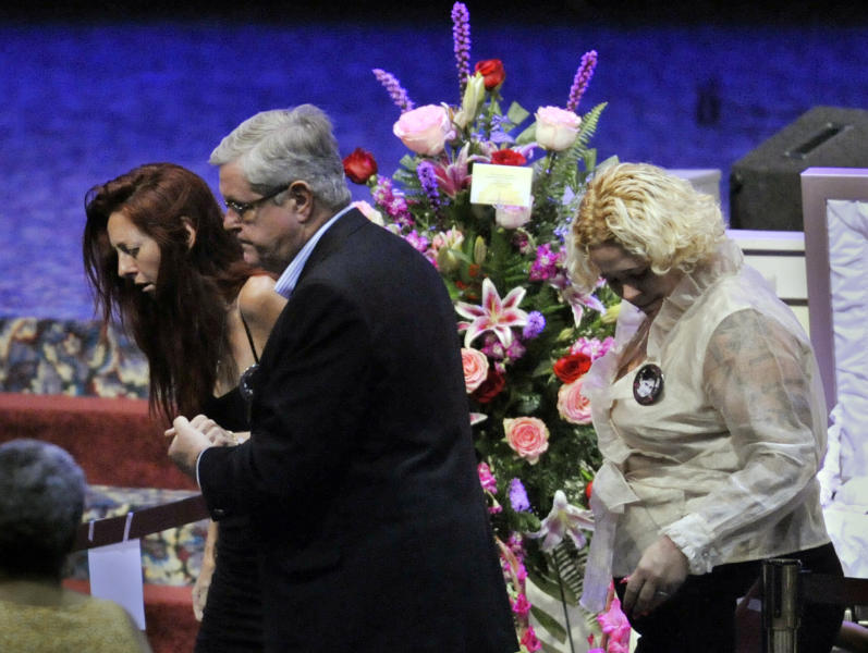 Rayne Perrywinkle, left, is lead away from the casket of her daughter, 8-year-old Cherish Perrywinkle, at Paxon Revival Center Church on Thursday, June 27, 2013 in Jacksonville, Fla. Cherish, who police say was targeted by a registered sex offender, was abducted and killed last Friday. (AP Photo/The Florida Times-Union, Will Dickey)
