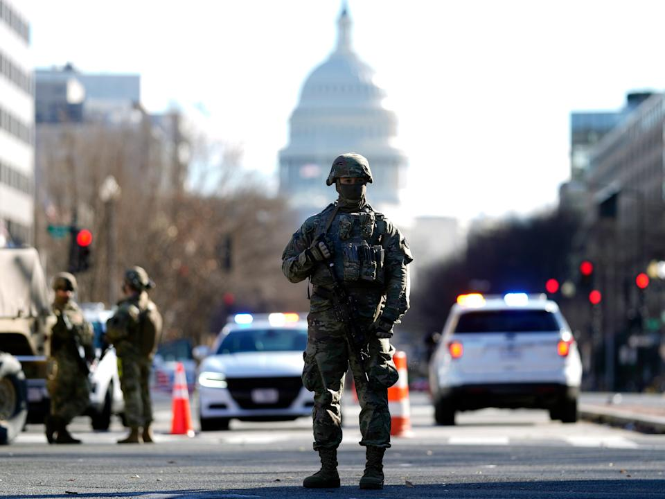Some 25,000 National Guard troops have been brought in from across the country to ensure security on Inauguration Day amid security concerns following a pro-Trump mob's attack on the Capitol on 6 JanuaryEPA