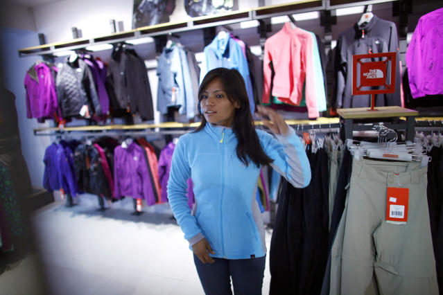 In this Tuesday, Feb. 21, 2013 photo, Nepalese climber Asha Singh looks at climbing gear at a store in Katmandu, Nepal. Aiming to change the all-male image of mountaineering in the country, a group of Nepalese women have embarked on a mission to climb the tallest mountain on each of the seven continents. The women, aged between 21 and 32, have already climbed Everest in Asia, Kosciuszko in Australia and Elbrus in Europe and are preparing next week to climb Mount Kilimanjaro in Africa to mark International Women's Day. (AP Photo/Niranjan Shrestha)