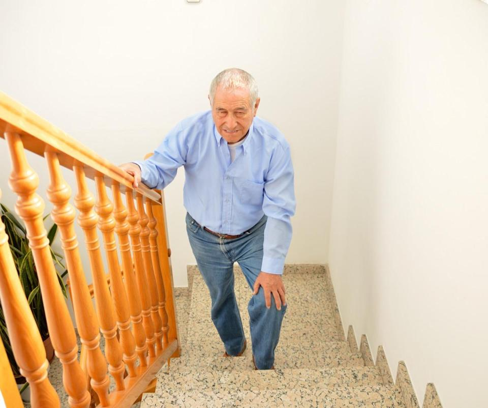 """Having difficulty walking or climbing stairs due to pain or weakness? It's time to schedule an appointment with your doctor. According to South Carolina-based urologist <strong><a href=""""https://atlanticurologyclinics.com/physicians/neal-shore/"""" rel=""""nofollow noopener"""" target=""""_blank"""" data-ylk=""""slk:Neal Shore"""" class=""""link rapid-noclick-resp"""">Neal Shore</a></strong>, MD, it's a symptom that can emerge as prostate cancer progresses. """"Men with advanced disease and their caregivers describe difficulty walking or climbing stairs,"""" he wrote on <a href=""""https://www.oncologynurseadvisor.com/home/departments/reflections/tell-me-about-your-prostate-cancer-symptoms-will-most-men-talk-or-walk/"""" rel=""""nofollow noopener"""" target=""""_blank"""" data-ylk=""""slk:Oncology Nurse Advisor"""" class=""""link rapid-noclick-resp"""">Oncology Nurse Advisor</a>. """"These symptoms can have a major impact on daily quality of life, but men with advanced disease don't always recognize these symptoms."""""""
