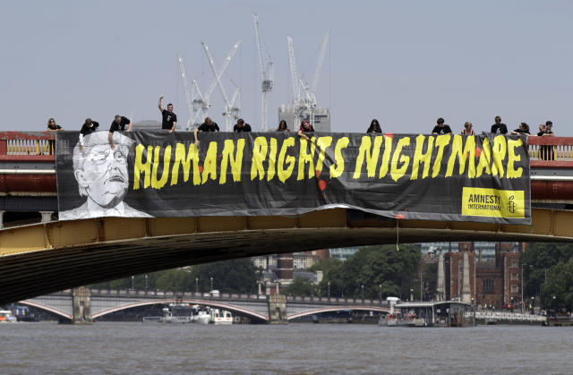 "<p>A giant ""Human Rights Nightmare"" banner is unfurled by Amnesty International activists across the river Thames on Vauxhall Bridge to protest against the visit of President Donald Trump, in London, Thursday, July 12, 2018. (Photo: Luca Bruno/AP) </p>"