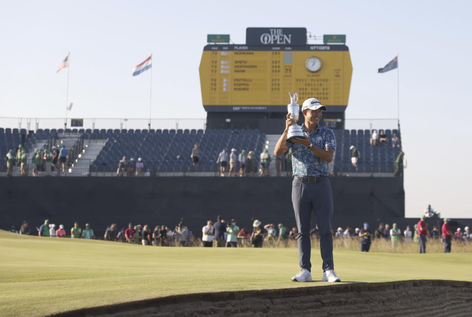 United States' Collin Morikawa holds the claret jug trophy as he poses for photographers on the 18th green after winning the British Open Golf Championship at Royal St George's golf course Sandwich, England, Sunday, July 18, 2021. (AP Photo/Peter Morrison)