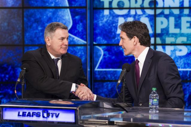 Tim Leiweke, left, president and CEO of Maple Leaf Sports and Entertainment, shakes hands with new Toronto Maple Leafs president Brendan Shanahan following a news conference in Toronto on Monday, April 14, 2014. Shanahan, a Hockey Hall of Famer, says he's eager to get to work learning about the organization, which missed the playoffs after a late-season collapse. (AP Photo/The Canadian Press, Chris Young)