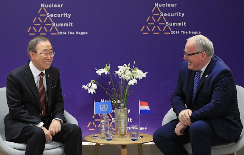U.N. Secretary General Ban Ki-moon, left, talks with Dutch Foreign Minister Frans Timmermans, at the Nuclear Summit in The Hague, the Netherlands, on Tuesday, March 25, 2014. Nuclear terrorism is officially the main topic for world leaders at a two-day summit in the Netherlands, in practice, the Ukraine crisis overshadows those talks. (AP Photo/Yves Logghe, Pool)