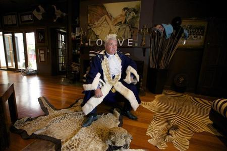 Newly elected Geelong Mayor, Darryn Lyons poses for a photograph in his mayoral robes in the living room of his home in Geelong