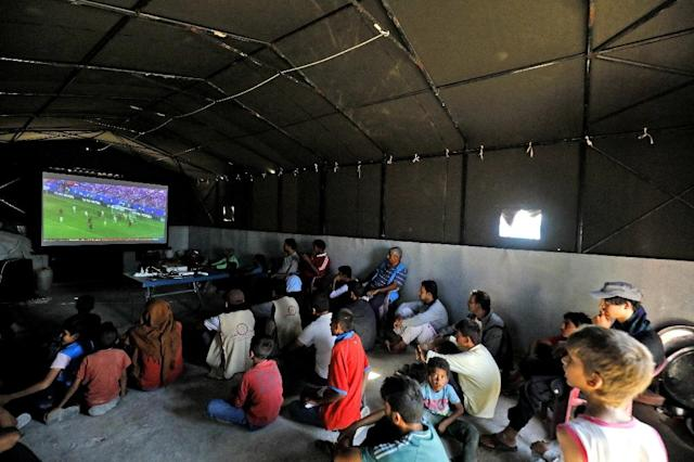 The free screenings are welcome as watching in a local cafe proved too expensive for many camp residents (AFP Photo/Delil SOULEIMAN)
