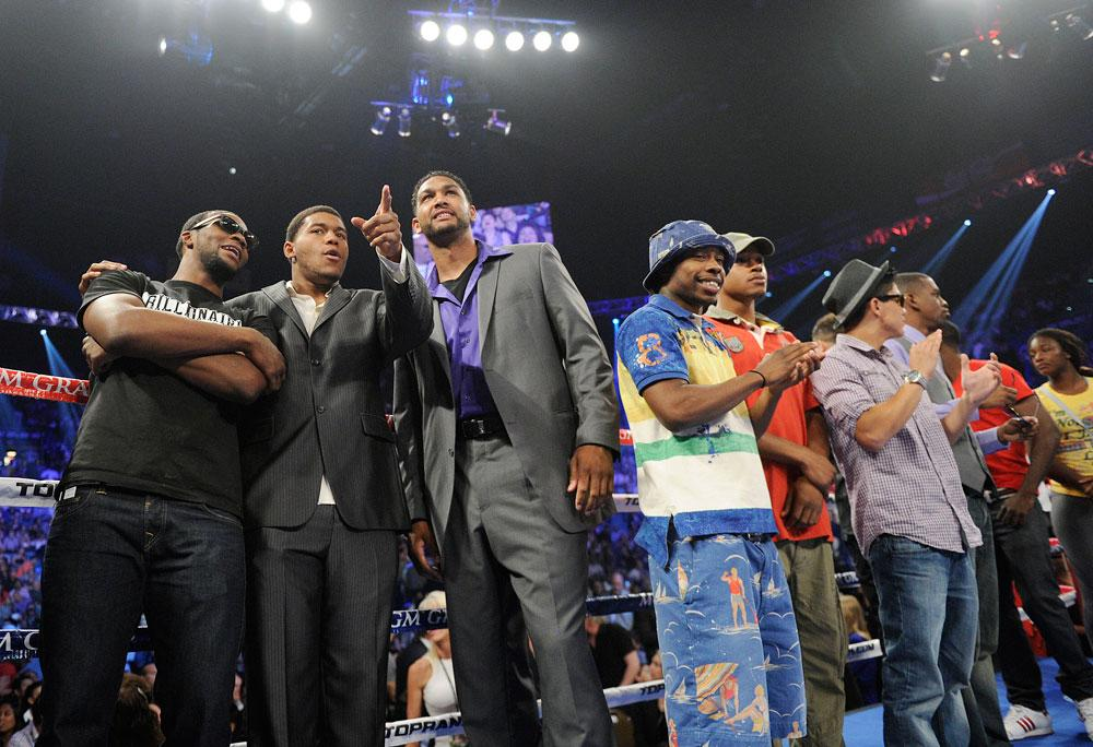Members of the men's and women's U.S. Olympic boxing teams take to the ring before the WBO welterweight title fight between Manny Pacquiao and Timothy Bradley on Saturday, June 9, 2012, in Las Vegas.