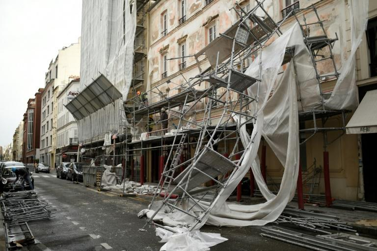 Part of the scaffolding was torn off a building in Paris on Wednesday as winter storm Eleanor whipped across northern France