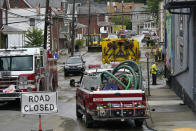Clean up from flooding on Baldwin street in Bridgeville, Pa. continues after downpours and high winds from the remnants of Hurricane Ida, hit the area Wednesday, Sept. 1, 2021. (AP Photo/Gene J. Puskar)