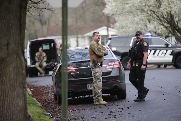 The streets surrounding Michael Mearan's home near the Scioto County Courthouse in Ohio are blocked by police vehicles and flooded with police personnel March 25.