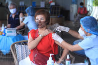 A woman receives a shot of the Moderna COVID-19 vaccine in Vung Tau, Vietnam, Monday, Sep. 13, 2021. Vietnam is speeding up its vaccination program in an effort to loosen coronavirus lockdown restrictions in major cities by the end of September, the government said. (AP Photo/Hau Dinh)