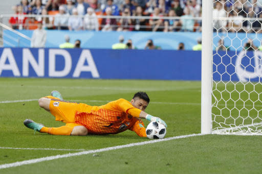 Japan goalkeeper Eiji Kawashima stops the ball during the group H match between Japan and Senegal at the 2018 soccer World Cup at the Yekaterinburg Arena in Yekaterinburg , Russia, Sunday, June 24, 2018. (AP Photo/Eugene Hoshiko)